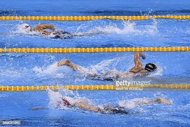 TOPSHOT USA's Katie Ledecky crosses Hungary's Katinka Hosszu and Canada's Hilary Caldwell during the Women's 800m Freestyle Final during the swimming...