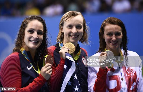 USA's Katie Ledecky poses on the podium with silver medallist Britain's Jazz Carlin and bronze medallist USA's Leah Smith after she won the Women's...