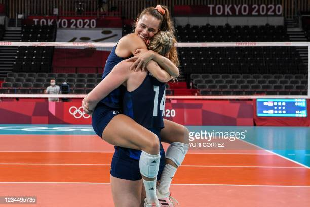 S Kelsey Robinson and Michelle Bartsch-Hackley celebrate their victory in the women's semi-final volleyball match between USA and Serbia during the...