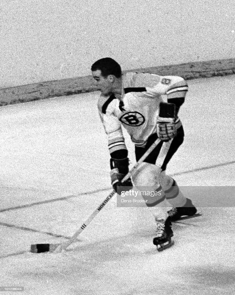 MONTREAL - 1970's: Ken Hodge #8 of the Boston Bruins skates against the Montreal Canadiens in the early 1970's at the Montreal Forum in Montreal, Quebec, Canada.