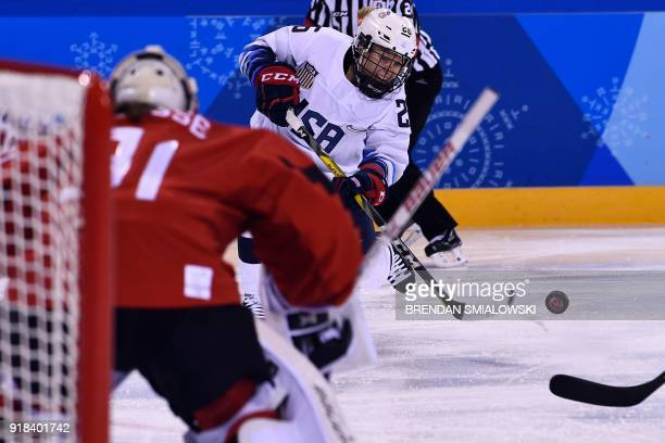 USA's Kendall Coyne controls the puck in the women's preliminary round ice hockey match between the US and Canada during the Pyeongchang 2018 Winter...