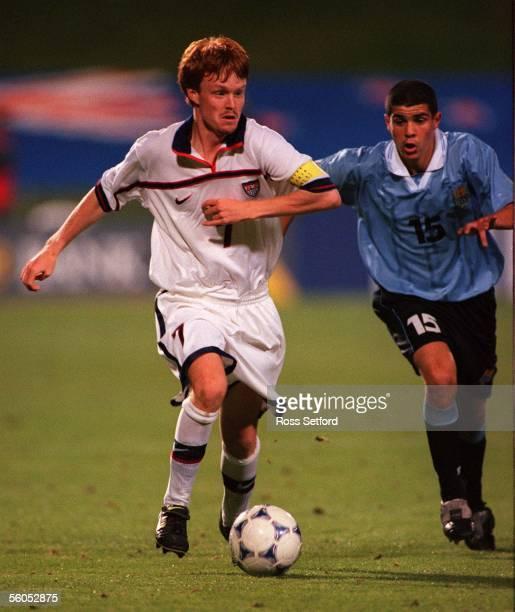 USA's Kenny Cutler runs down Uruguay's Ignacio Portillo in the FIFA under 17 World Championship at North Harbour Stadium Albany TuesdayUSA won 10