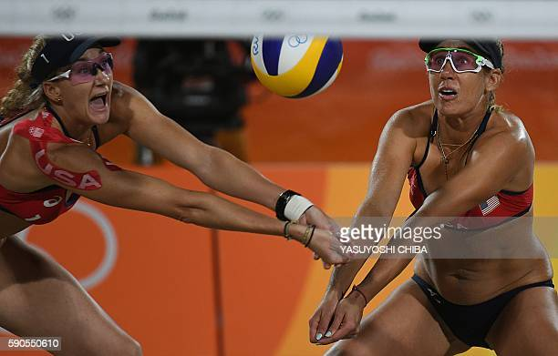 USA's Kerri Walsh Jennings and USA's April Ross control the ball during the women's beach volleyball semifinal match between USA and Brazil at the...
