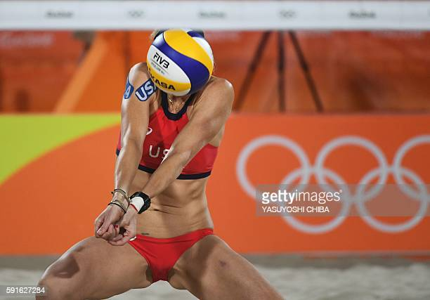 USA's Kerri Walsh Jennings controls the ball during the women's beach volleyball bronze medal match between Brazil and the USA at the Beach Volley...