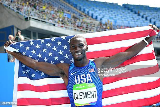 USA's Kerron Clement celebrates winning the gold medal in the Men's 400m Hurdles Final during the athletics event at the Rio 2016 Olympic Games at...