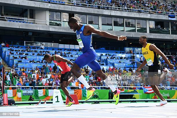 USA's Kerron Clement crosses the finish line to win the gold medal in the Men's 400m Hurdles Final during the athletics event at the Rio 2016 Olympic...