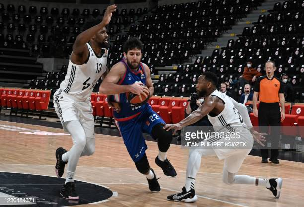 S Kevarrius Hayes of the US and David Lighty of the US fight for the ball with Anadolu Efes' James Anderson of the US during the Euroleague...