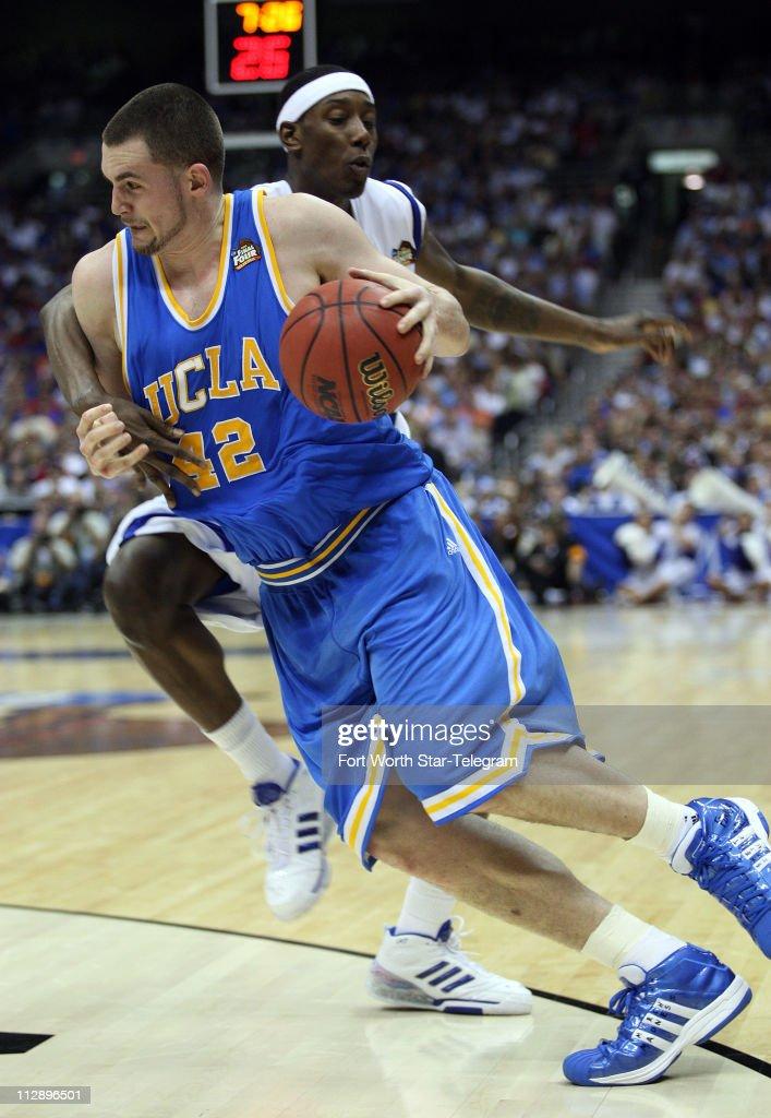 UCLA's Kevin Love battle to get past Memphis defender ...