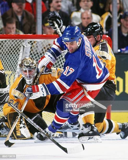BOSTON MA 1990's Kevin Stevens of the New York Rangers skates after puck against the Boston Bruins at the Fleet Center