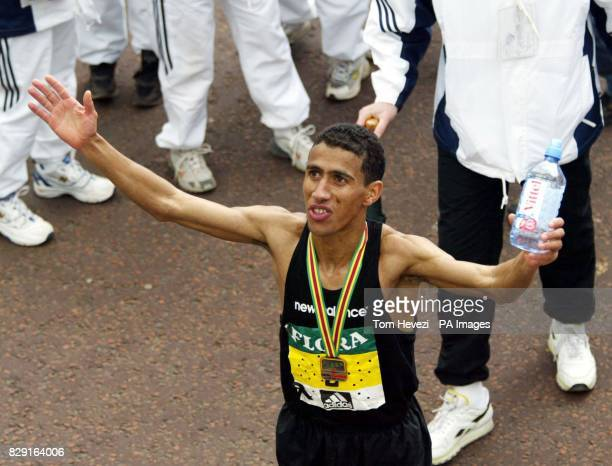USA's Khalid Khannouchi celebrates winning the Flora London Marathon Khalid Khannouchi smashed his own world record in an official time of two hours...