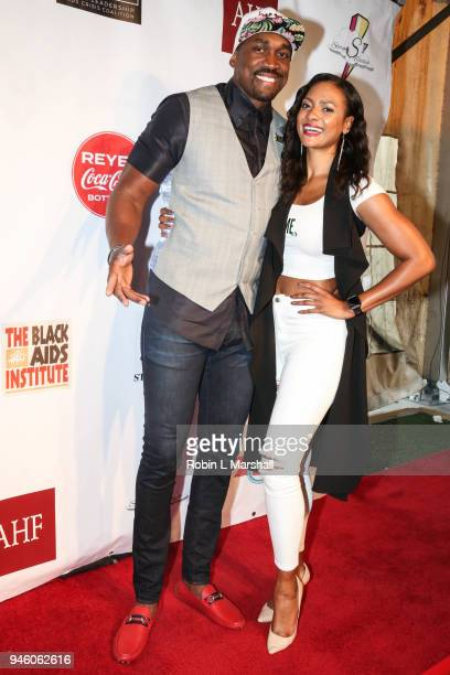 NBA's Kibwe Trim and model Joslyn Pennywell attend the 12th Annual Santee High School Fashion Show at Los Angeles Trade Technical College on April 13...
