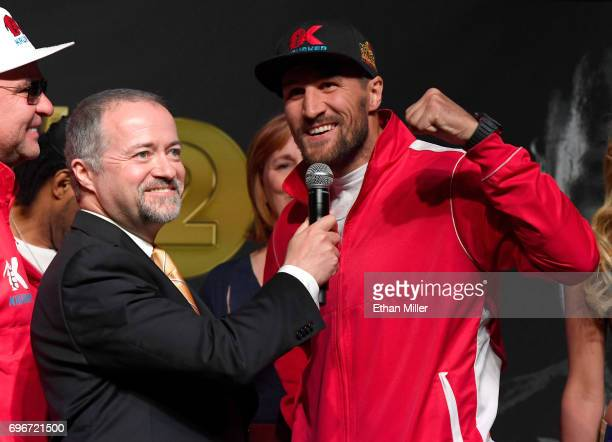 HBO's Kieran Mulvaney interviews boxer Sergey Kovalev after his official weighin at the Mandalay Bay Events Center on June 16 2017 in Las Vegas...