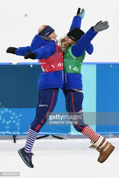 USA's Kikkan Randall and USA's Jessica Diggins celebrate their gold win in the women's cross country team sprint free final at the Alpensia cross...