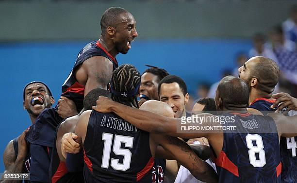 S Kobe Bryant celebrates with teammates at the end of the men's basketball gold medal match Spain against The US of the Beijing 2008 Olympic Games on...