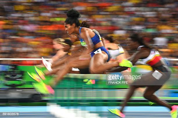 S Kristi Castlin competes in the Women's 100m Hurdles Semifinal during the athletics event at the Rio 2016 Olympic Games at the Olympic Stadium in...