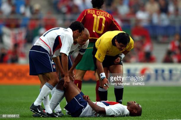 S Landon Donovan , Earnie Stewart and Referee Byron Moreno stand over the injured Eddie Pope