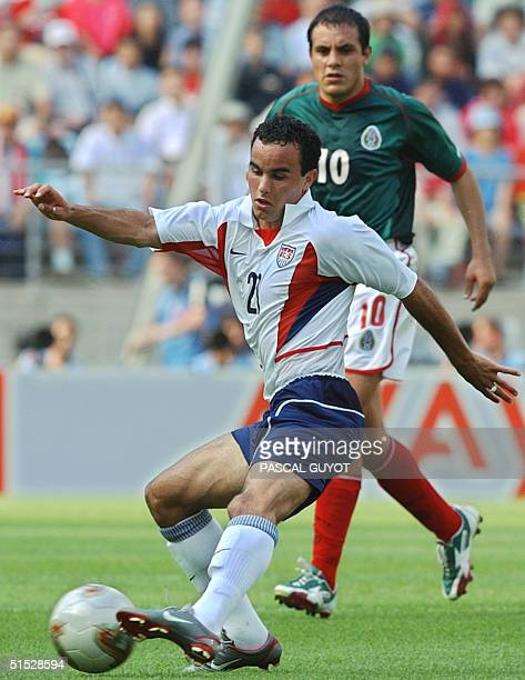 S Landon Donovan shoots ahead of Mexico's Cuauhtemoc Blanco , 17 June 2002 at the Jeonju World Cup Stadium in Jeonju, during second round playoff...