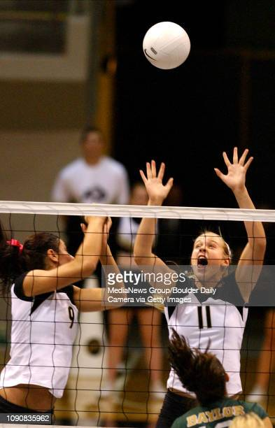 CU's Lara Bossow right jumps to block while watched by teammate Allie Griffin against Adeline Meira of Baylor