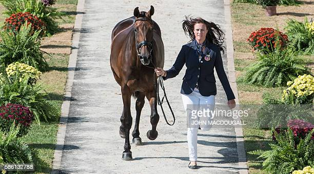 USA's Lauren Kieffer leads Veronica to a trot during the first horse inspection of the Equestrian's Eventing phase during the 2016 Rio Olympic Games...