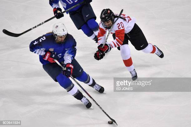 USA's Lee Stecklein and Canada's Sarah Nurse fight for the puck in the women's gold medal ice hockey match between the US and Canada during the...