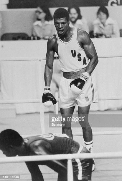 S Leon Spinks, of St. Louis, Missouri, scored a knockdown in the 1st round, as Cuba's Sixto Soria is down in the foreground. Spinks went on to knock...