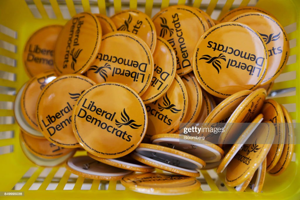 U.K.'s Liberal Democrat Party badges sit at the party's annual conference in Bournemouth, U.K., on Tuesday, Sept. 19, 2017. Cable said U.K. Prime Minister Theresa May should fire her foreign secretary, Boris Johnson, over an article he published on Saturday about Britains departure from the European Union. Photographer: Luke MacGregor/Bloomberg via Getty Images