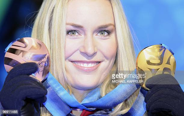 USA's Lindsey Vonn displays her bronze and gold medal during the medal ceremony for the Alpine skiing Women's SuperG event of the Vancouver 2010...