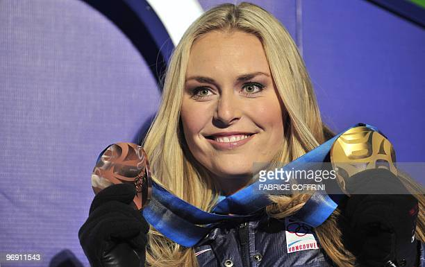 USA's Lindsey Vonn displays her bronze and gold medals during the medal ceremony for the Alpine skiing Women's SuperG event of the Vancouver 2010...