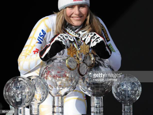 S Lindsey Vonn poses infront crystal globes on the podium on March 14, 2009 at the Ski World Cup finals in Are. USA's Lindsey Vonn won the overall...