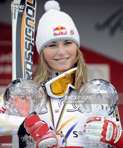 S Lindsey Vonn poses with her Super G and her downhill globe after the women's Super-G on March 12, 2009 at the Ski World Cup finals in Are. American...