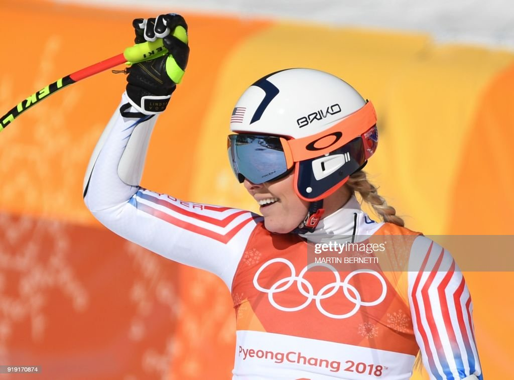 USA's Lindsey Vonn reacts after crossing the finish line of the Women's Super-G at the Jeongseon Alpine Center during the Pyeongchang 2018 Winter Olympic Games in Pyeongchang on February 17, 2018. / AFP PHOTO / Martin BERNETTI