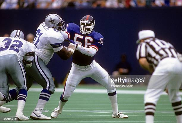 RUTHERFORD NJ CIRCA 1990's Linebacker Lawrence Taylor of the New York Giants is blocked by offensive tackle Nate Newton of the Dallas Cowboys circa...