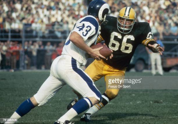 S: Linebacker Ray Nitschke of the Green Bay Packers chase down a Los Angeles Rams running-back during a circa 1960's NFL football game at Lambeau...