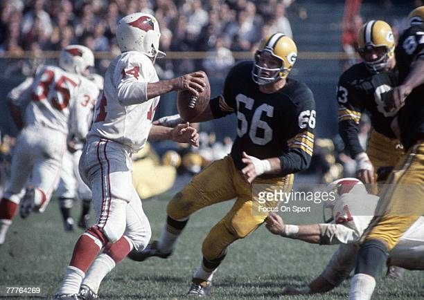 BAY WI CIRCA 1960's Linebacker Ray Nitschke of the Green Bay Packers rushes the quarterback against the St Louis Cardinals during a circa 1960's NFL...