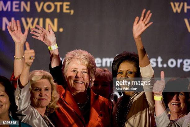 EMILY's List president Ellen Malcolm center left and Michelle Obama center right are surrounded by elected female Democratic officials at an EMILY's...