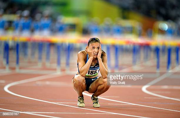 AUGUST 19TH 2008––USA's Lolo Jones looks at the replay in disbelief after tripping over a hurdle while leading in the Women's 100m Hurdles at the...