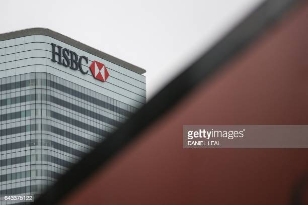 HSBC's London headquarters are pictured in the financial district Canary Wharf in London on February 21 2017 HSBC profits plunged last year on huge...
