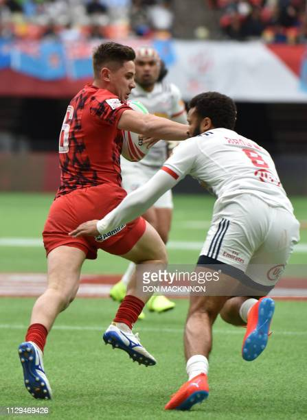 USA's Maceo Brown attempts to stop Daf Smith of Wales during World Rugby Sevens Series action in Vancouver Canada March 9 2019