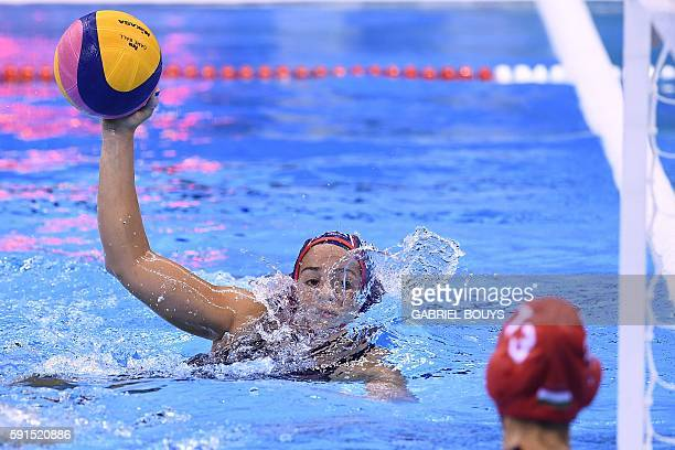 TOPSHOT USA's Maddie Musselman looks at Hungary's Orsolya Kaso during their Rio 2016 Olympic Games water polo semifinal game at the Olympic Aquatics...