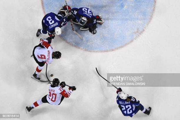 USA's Madeline Rooney defends against Canada's Jennifer Wakefield and Sarah Nurse in the women's gold medal ice hockey match between the US and...