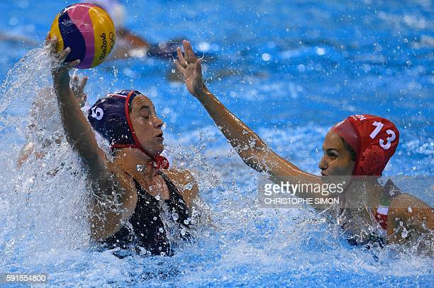 USA's Maggie Steffens is marked by Hungary's Orsolya Kaso during their Rio 2016 Olympic Games women's water polo semifinal game at the Olympic...