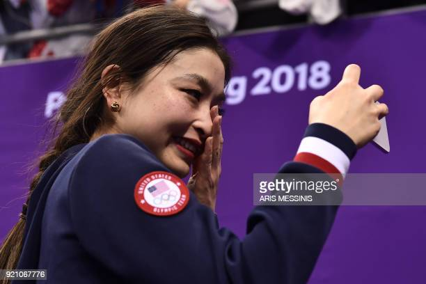 TOPSHOT USA's Maia Shibutani wipes tears while taking following her bronze win with partner USA's Alex Shibutani following the venue ceremony after...