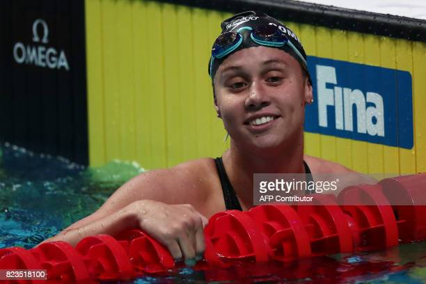 USA's Mallory Comerford reacts after competing in a women's 100m freestyle semifinal during the swimming competition at the 2017 FINA World...
