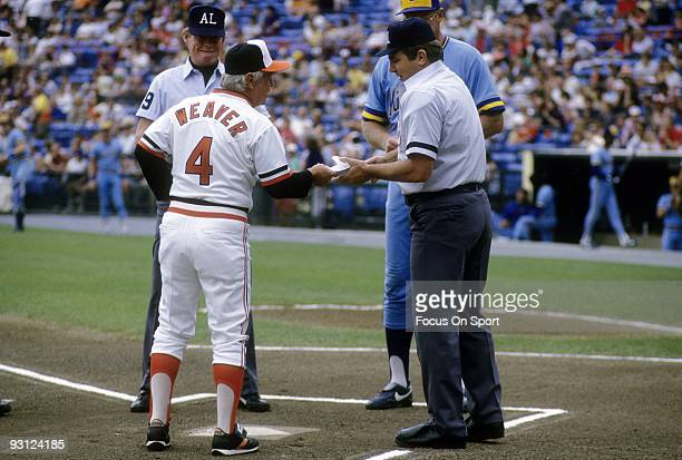 BALTIMORE MD CIRCA 1970's Manager Earl Weaver of the Baltimore Orioles hands over his lineup card to the home plate umpire prior to a mid 1970's MLB...