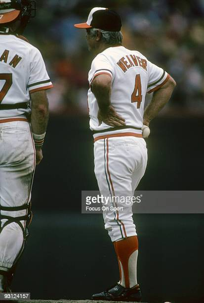 S: Manager Earl Weaver of the Baltimore Orioles standing on the pitchers mound waiting to hand the ball over to a new pitcher to enter the game...