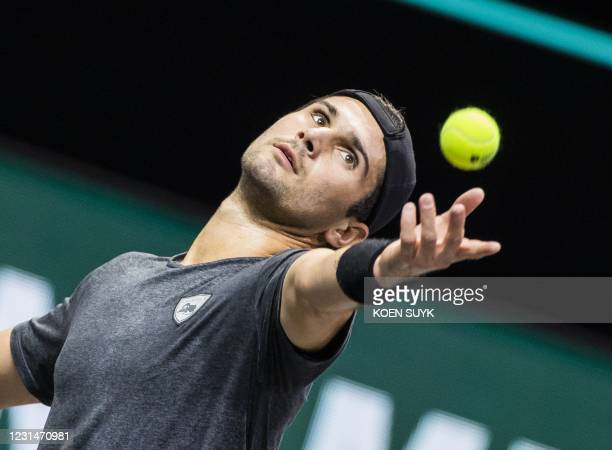S Marcos Giron serves to Russia's Andrey Rublev on the second day of the Rotterdam ATP tennis tournament, on March 2, 2021. / Netherlands OUT