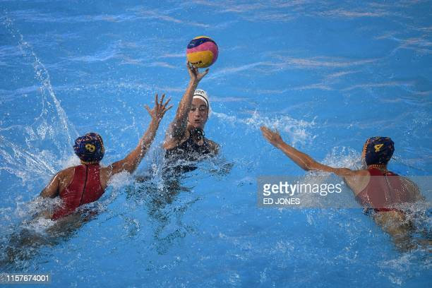 USA's Margaret Steffens vies for the ball with Spain's Maria Pena Carrasco and Spain's Beatriz Ortiz Munoz during the women's final match between USA...