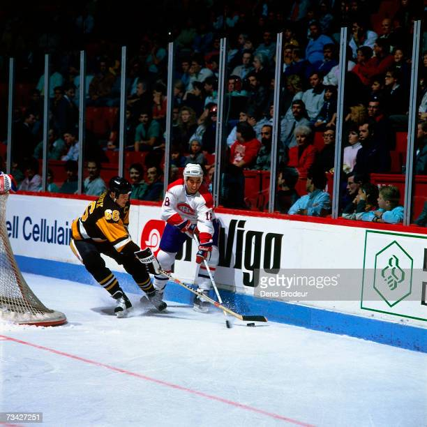 MONTREAL 1990's Mario Lemieux of the Pittsburgh Penguins and Denis Savard of the Montreal Canadiens skate for the puck behind the net