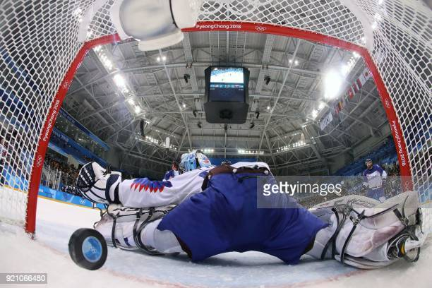TOPSHOT USA's Mark Arcobello scores a goal in the men's playoff qualifications ice hockey match between and during the Pyeongchang 2018 Winter...