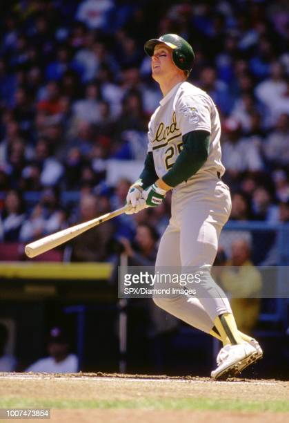 CIRCA 1980's Mark McGwire of the Oakland A's at bat during a game from his career with the Oakland A's Mark McGwire played for 16 years with 2...